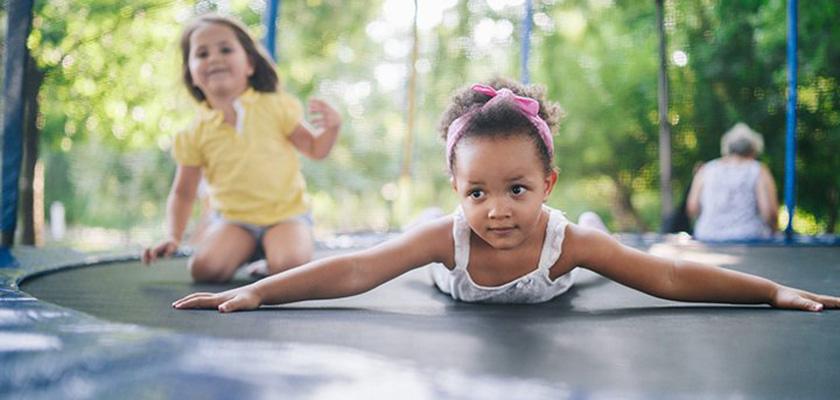 Girls playing on trampoline