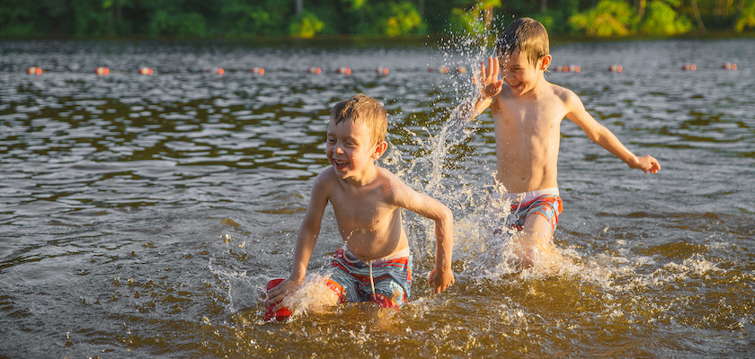 Two-young-boys-playing-in-the-lake