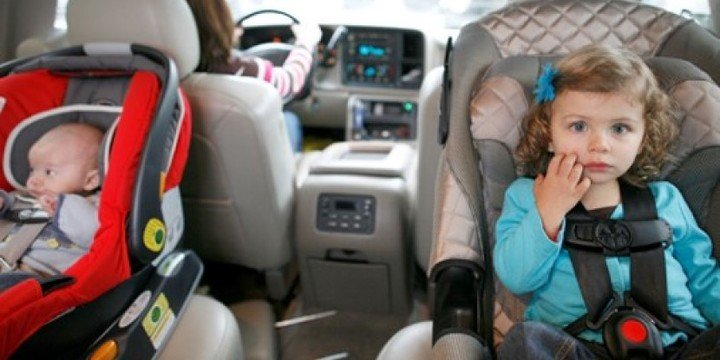 Toddler and infant in car seats