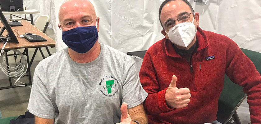 Photo of two men giving the thumbs up after receiving the COVID-19 vaccine at UVM Medical Center.