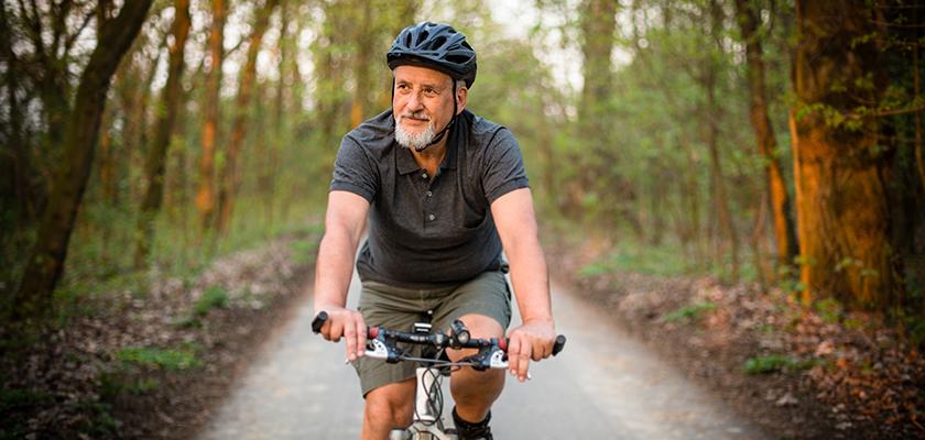 Man riding bike outside