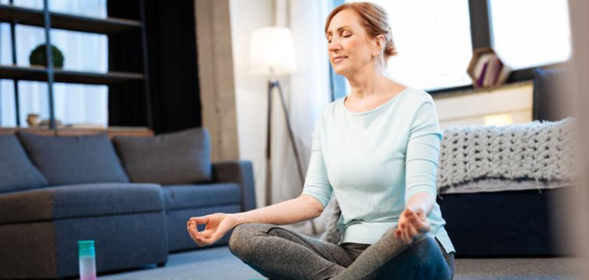 Woman sitting cross legged, meditating