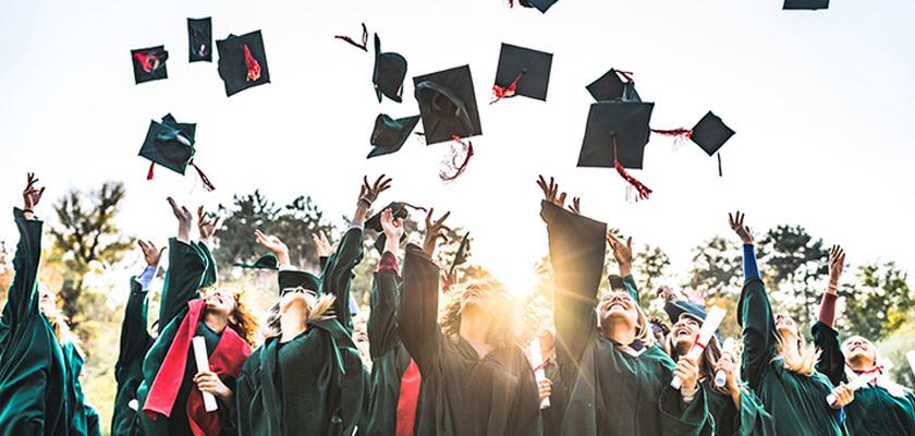 Graduates for throwing caps in air
